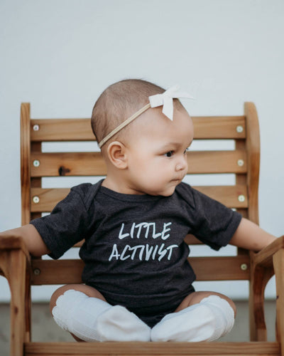 Apparel & Accessories > Clothing > Baby & Toddler Clothing > Baby One Pieces - Little Activist Bodysuit
