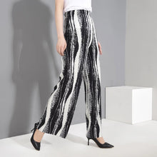 RIVOLI PLEATED PANTS