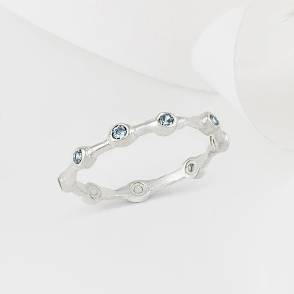 Aura Blue Topaz and Silver Eternity Ring Band