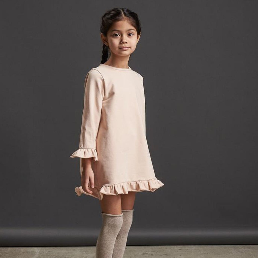Girls' tunic dress by Il Guardarobino in light pink in warm cotton fleece with ruffles and a bow closing on the back