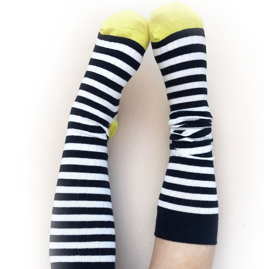 kid wearing Fine cotton knee-high socks in Navy Made from a high quality Italian-spun cotton