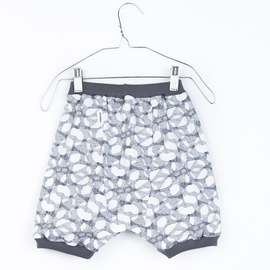 Baby knitted pants in a halftone print with contrasting waist and legs by Motoreta