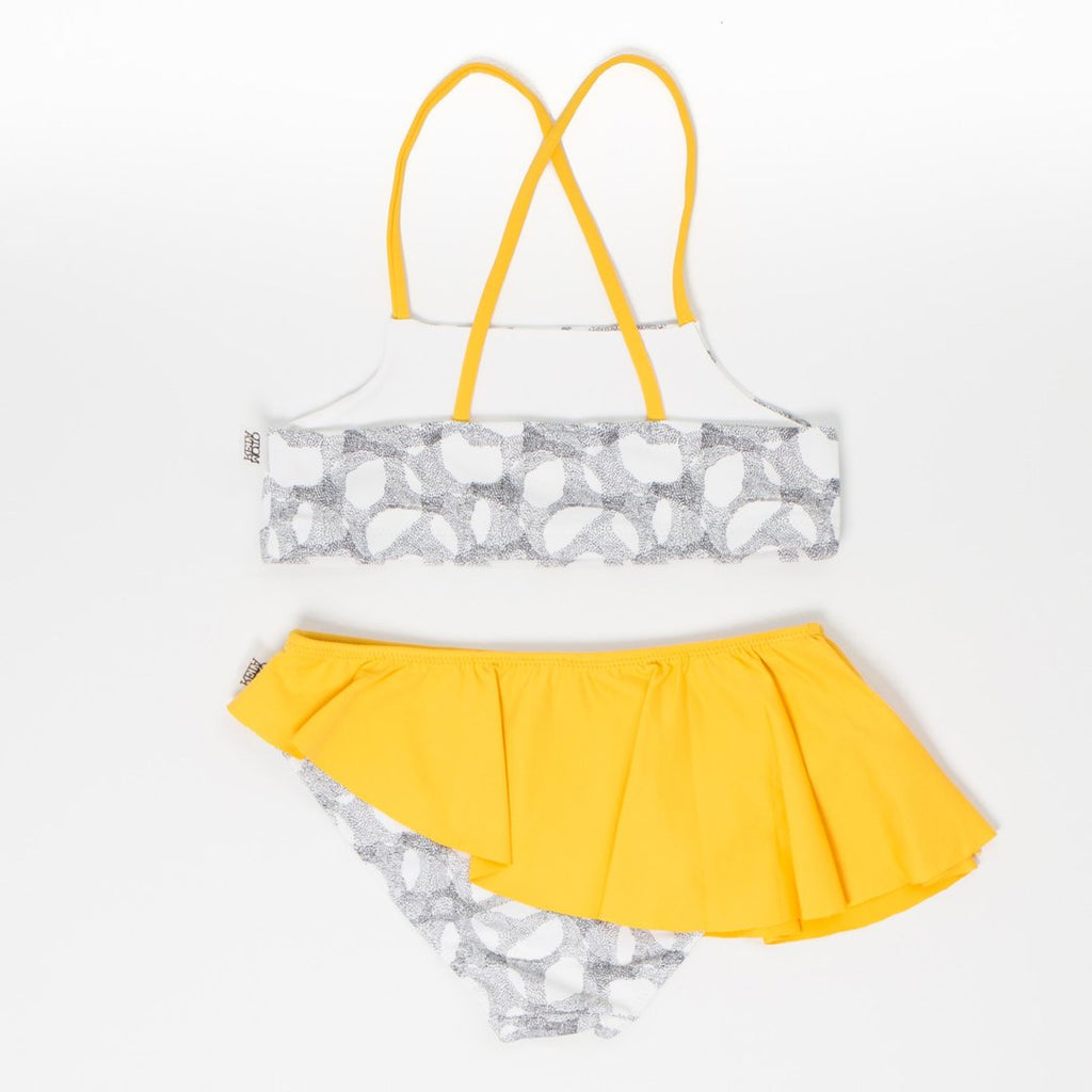 Girls bikini in yellow and halftone woth a criss-cross top and a ruffled bottom by Motoreta