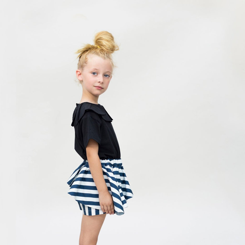 Toddler wearing blue and white baby girl skort by Motoreta