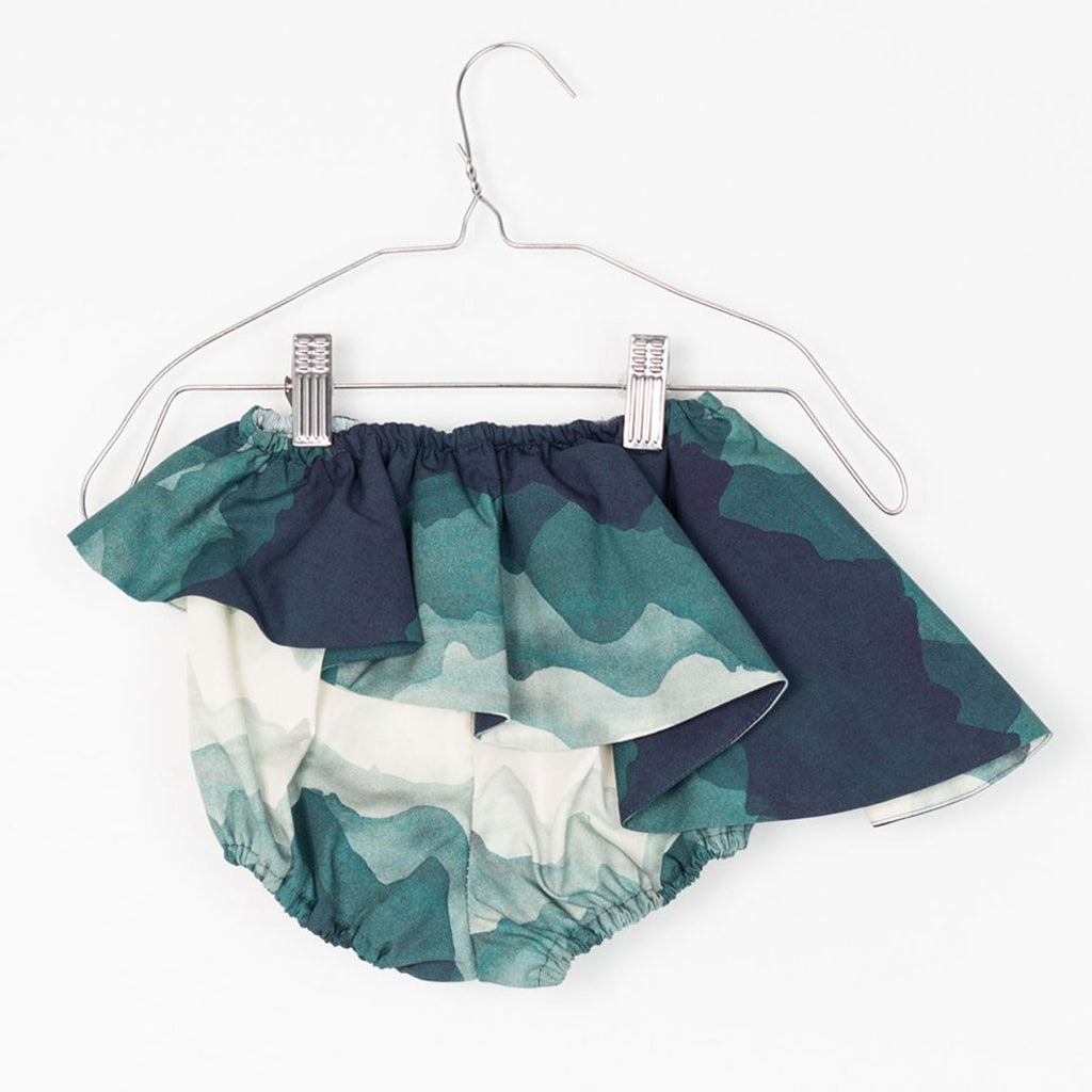 Baby bloomers with a landscape print, featuring ruffles and an elastic band by motoreta