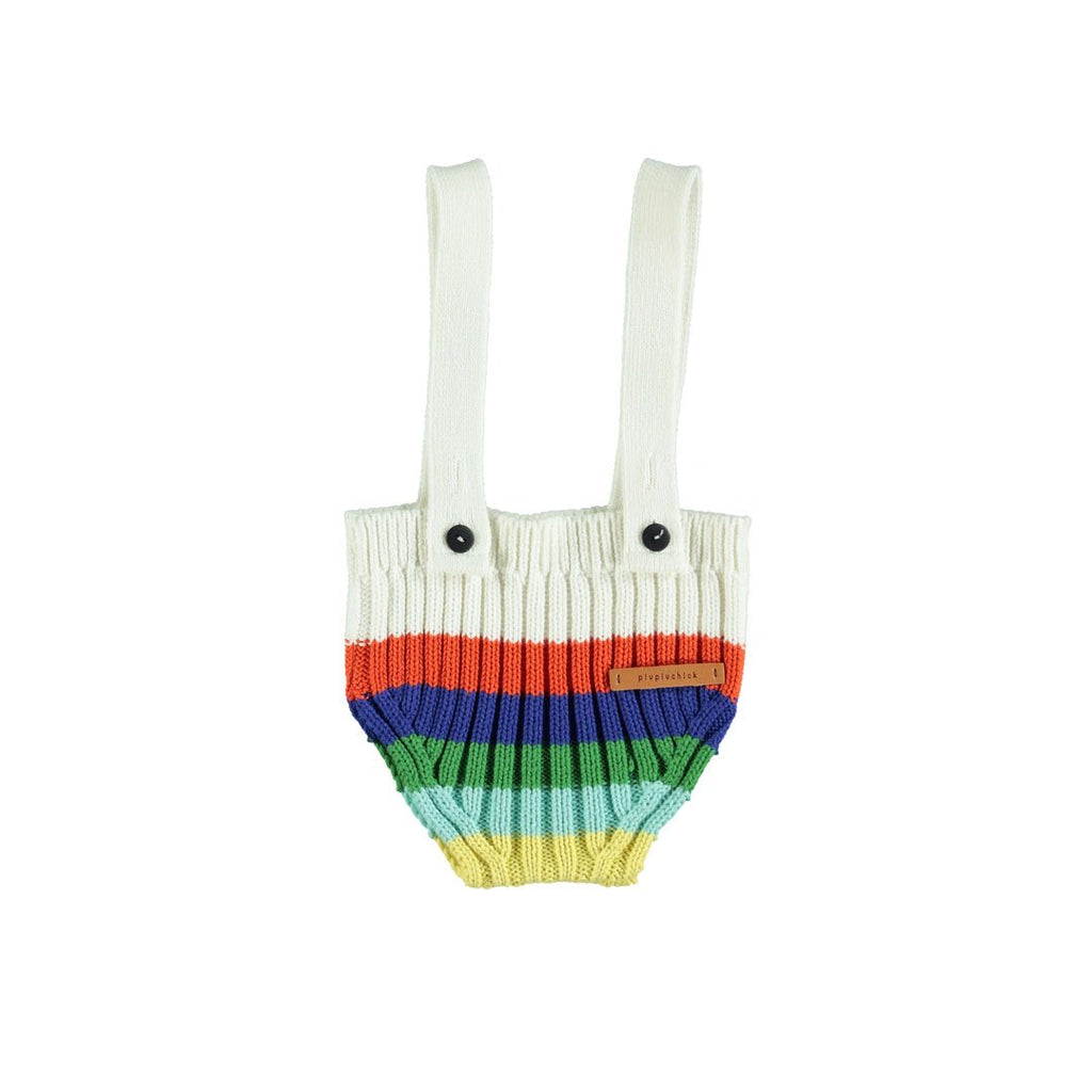Baby bottoms by Piupiuchick in knitted cotton, with removable suspenders, feaure a colorful rainbow knit on an ecru base.
