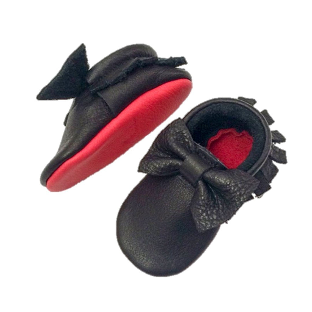Beautiful handmade baby girl shoes with the signature red sole by Little Lambo