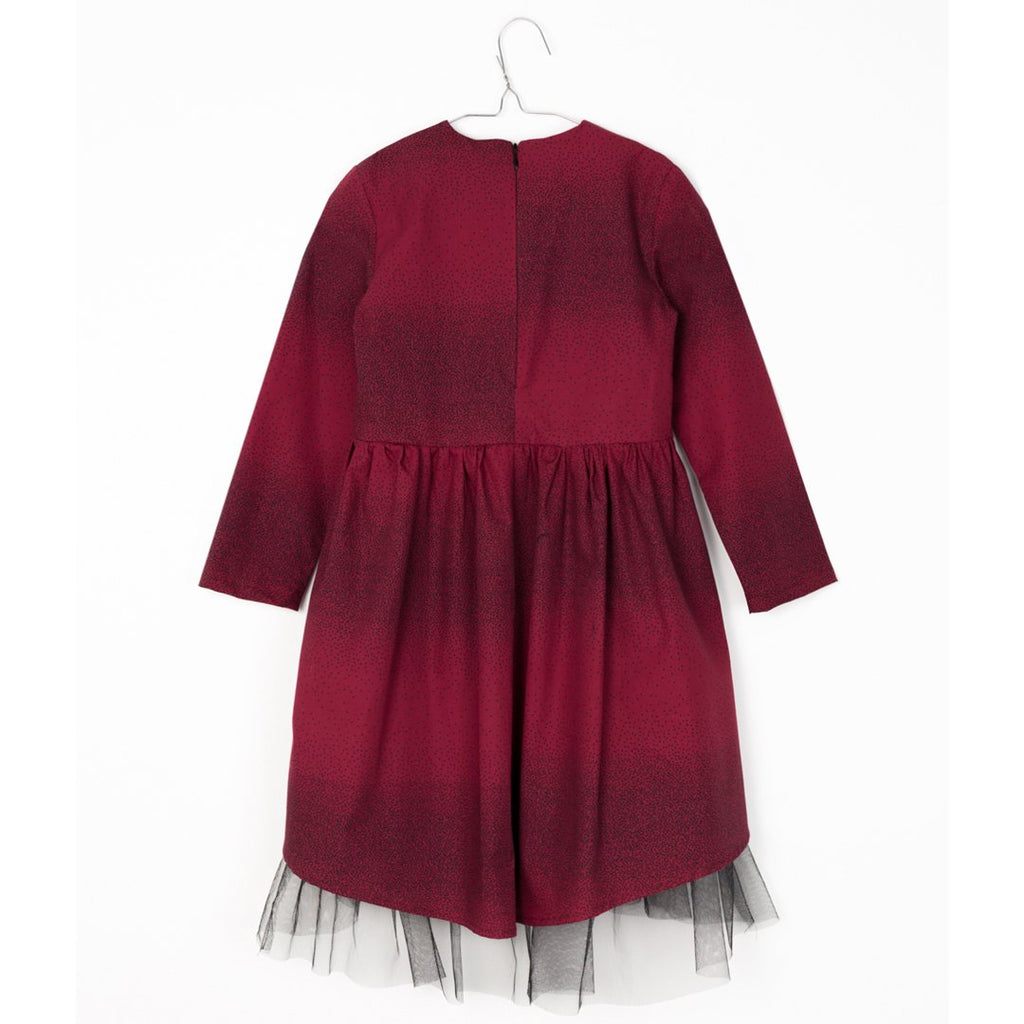 girl wearing Long-sleeve girls dress in burgundy with black dots and black tulle in the lower layer by motoreta