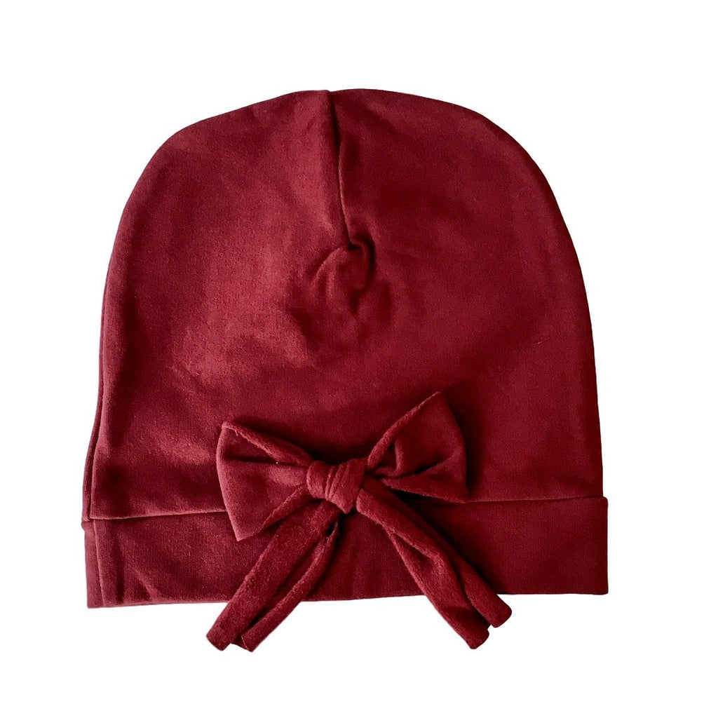 Girls beanie with a  bow on the back by Il Guardarobino