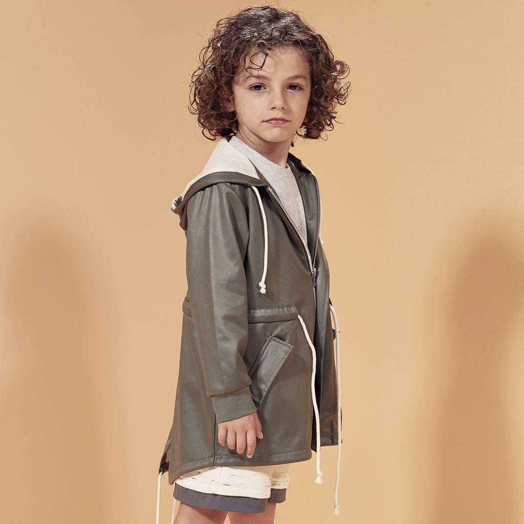Boy wearing parka made from the best italian fabrics, in army green with beige inner linings and details and an elasticated waist by I Leoncini