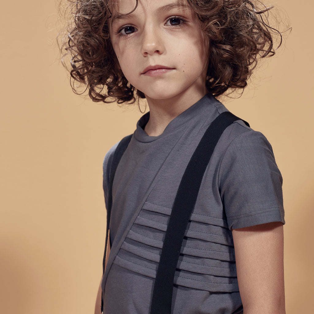 Boy in dark gray boys t-shirt with embossed details on the front by I Leoncini