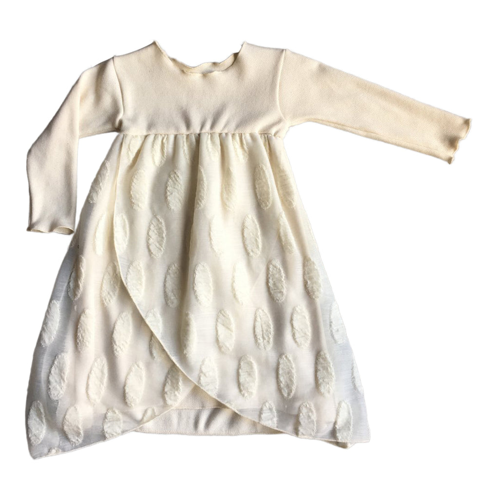 Layered cream dress in cotton and wool, the top layer fabric has oval details.
