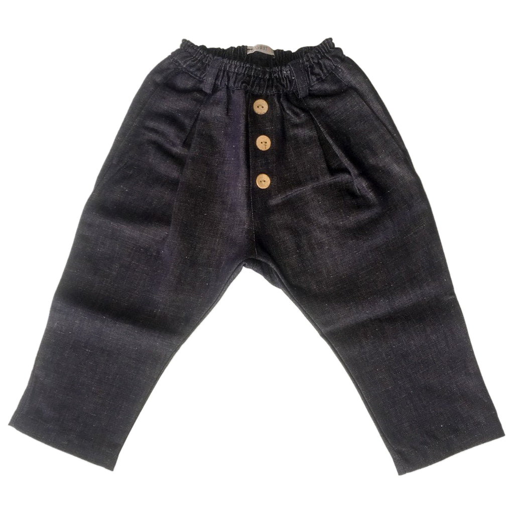 Dark blue denim jeans featuring coconut buttons on the front and a loose, comfortable fit by Chichirikids