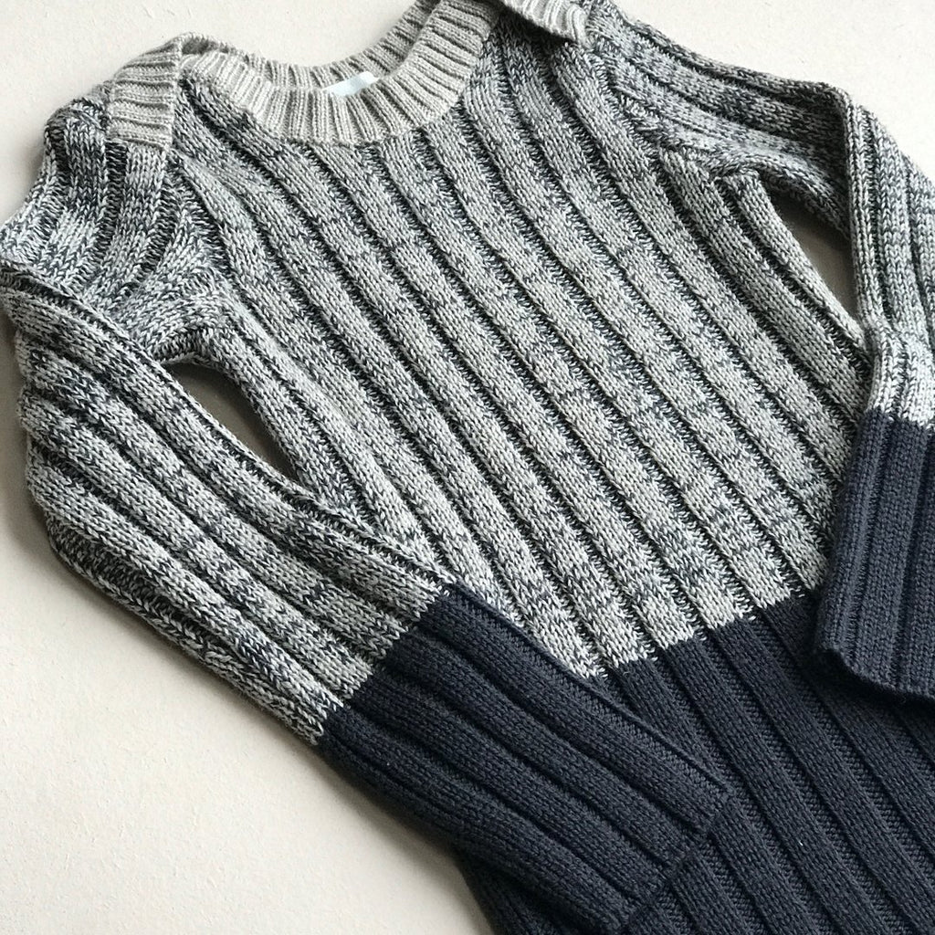 Brenin ribbed top in a combination of shades of gray, from ivory to ink makes it a perfect unisex top for autumn and winter.