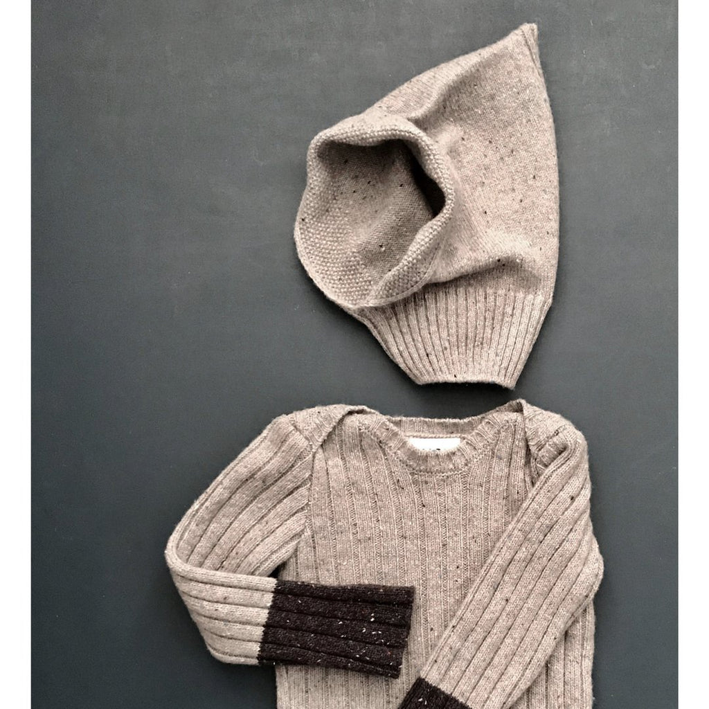 This warm donegal hooded hat for babies