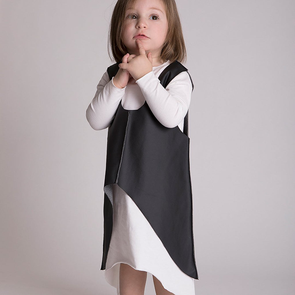 Toddler wearing long white asymmetric dress in soft cotton jersey by Gayalab