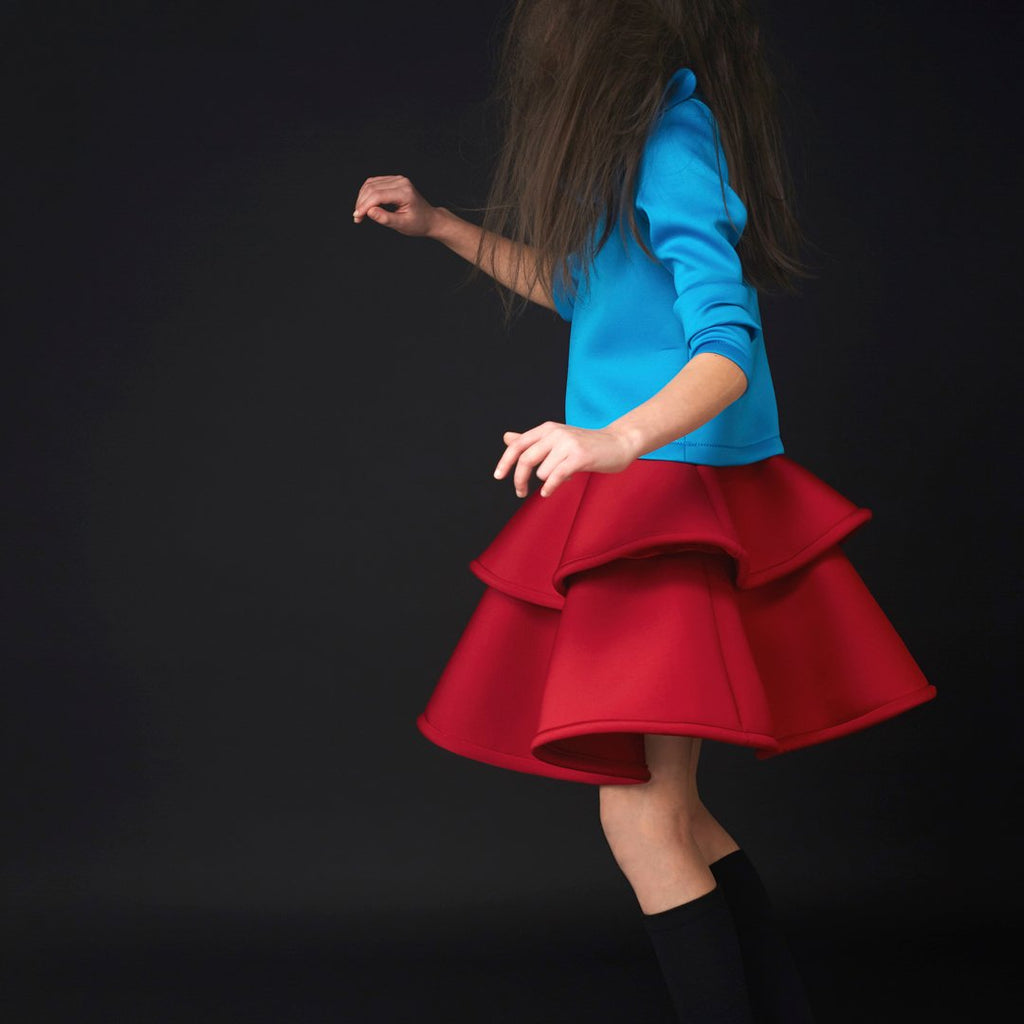 Girl in Structured two-layer skirt in beautiful ruby red color by Nikolia