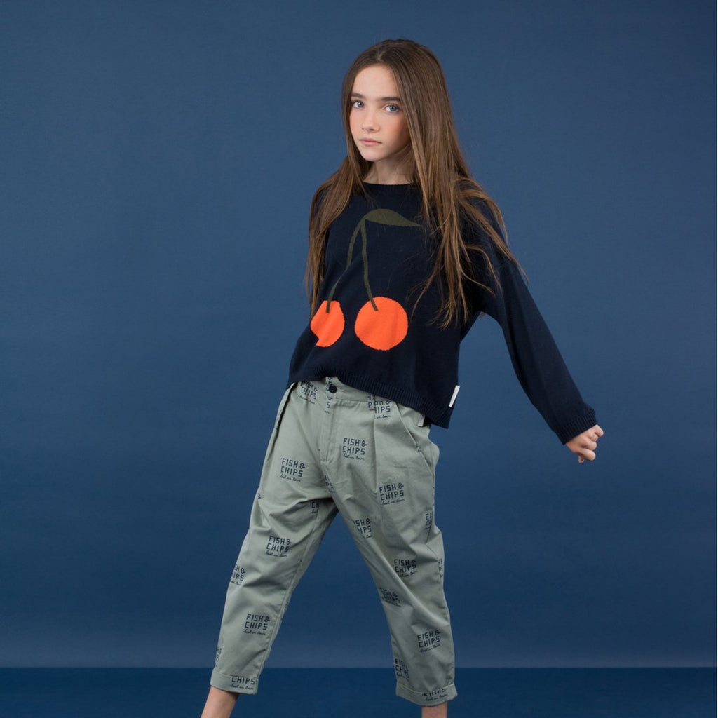 Kid wearing Cherries Unisex Knit Sweater