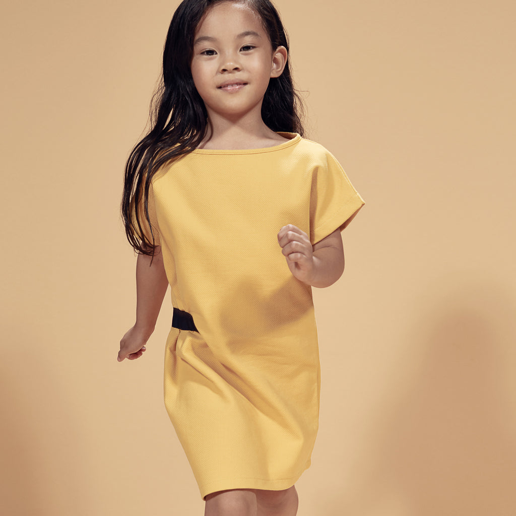 Girl in yellow shift dress, with a loose fit and straight cut by I Leoncini