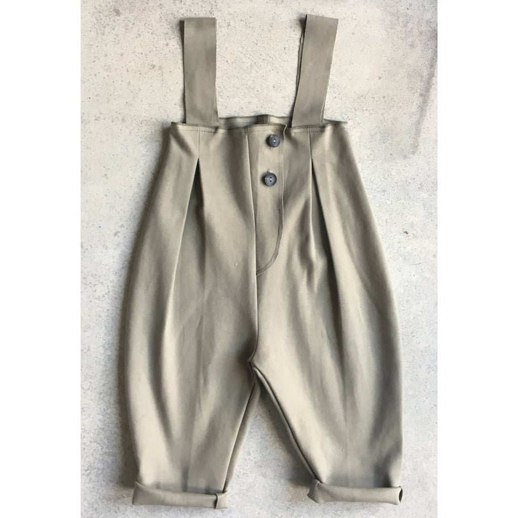 Toddler and kids unisex overalls in a neutral green. A great unisex one-piece which is also really fun to mix and match.