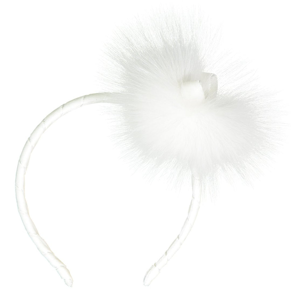 White headband with big side furry pom pom in matching color and a bow in the middle by Illy Trilly