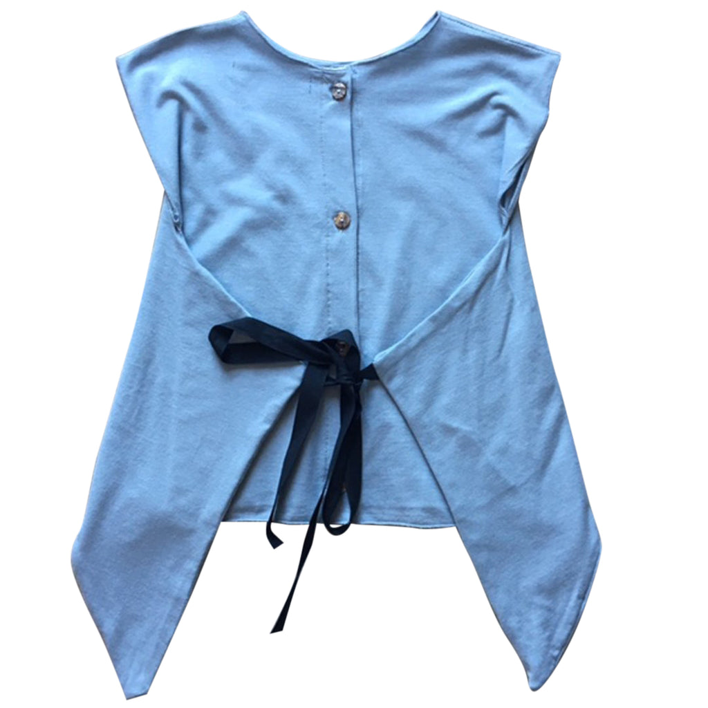 Girls sleeveless top featuring buttons and a wrap closing with a bow on the back by Gayalab