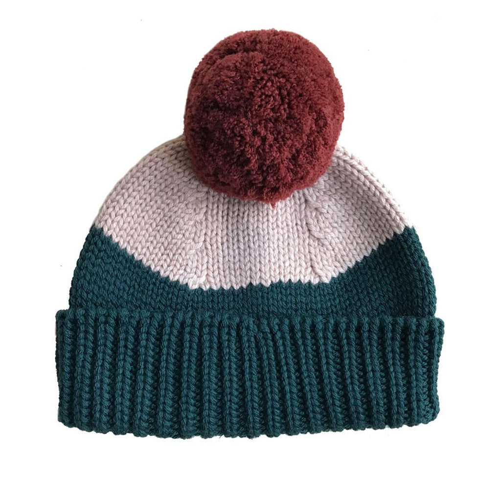 merino wool beanie with a fluffy pom pom in redwood, forest and blush combination.