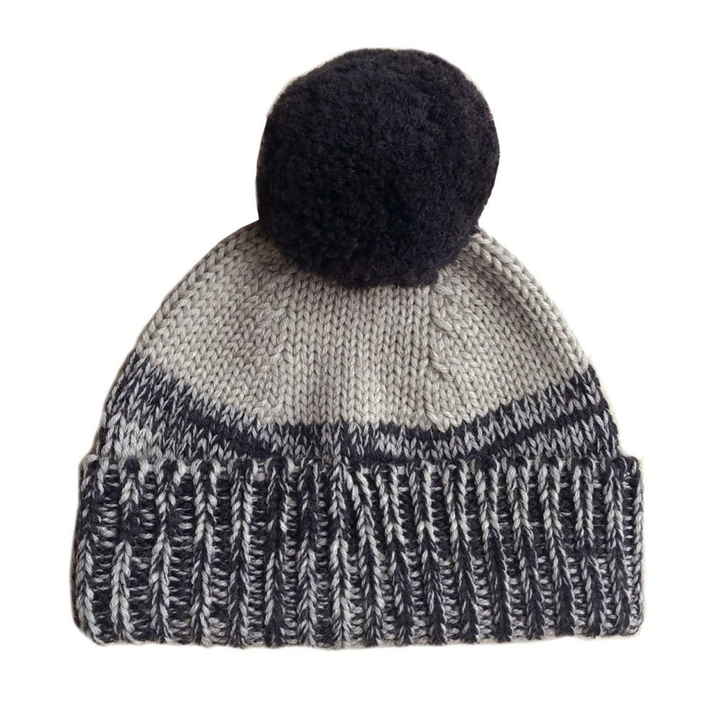 merino wool beanie with a fluffy pom pom in a wheat and ink combination.