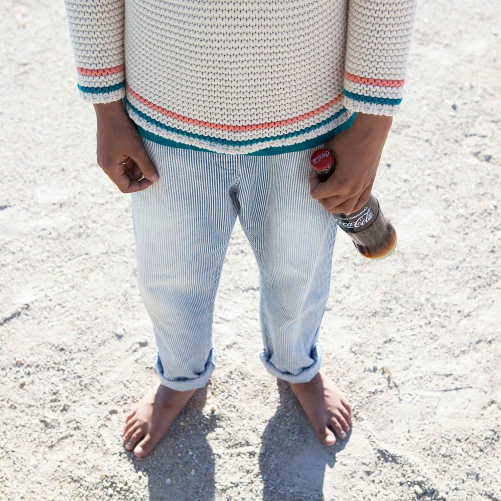 Boy wearing striped denim jeans with a washed effect by Piupiuchick