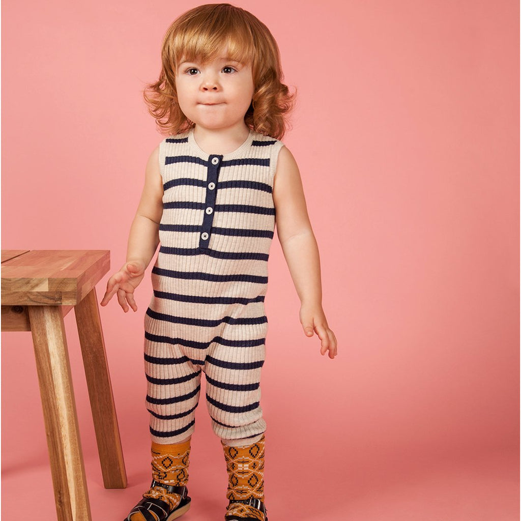 toddler wearing unisex summer sleeveless romper in indigo and ecru stripes by Mabli