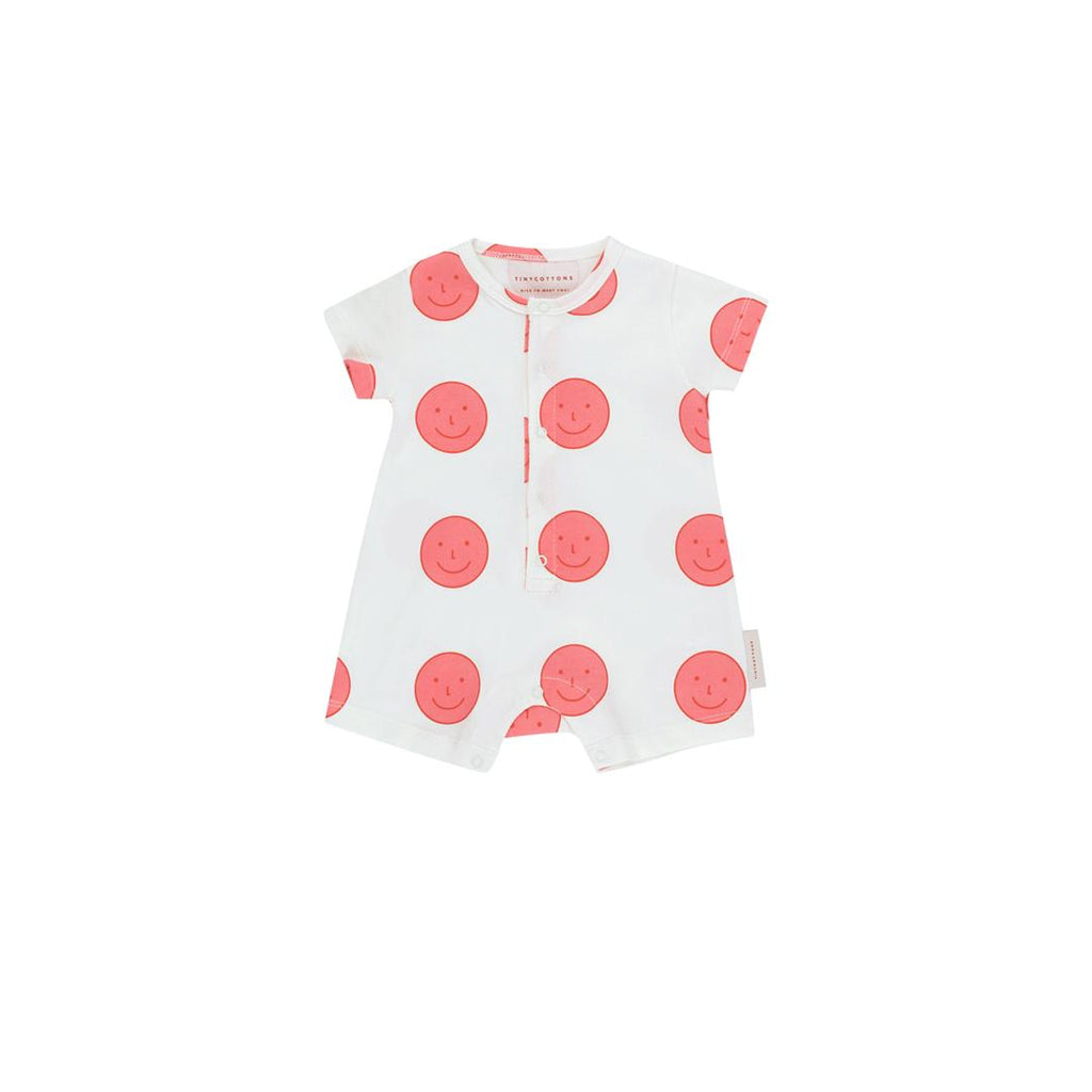 Off-white terry base one-piece with happy print faces all-over in pink