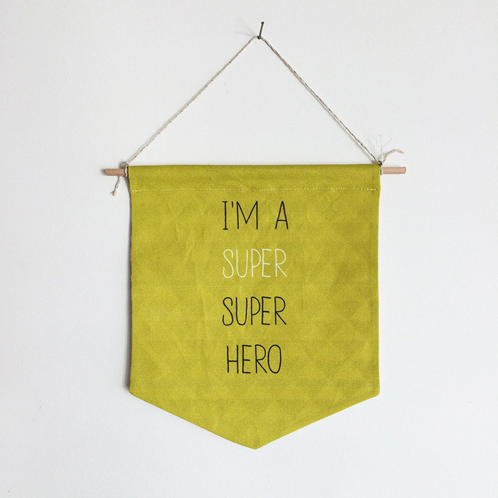 Colourful banner in yellow is perfect for the room decor by Lili Moko