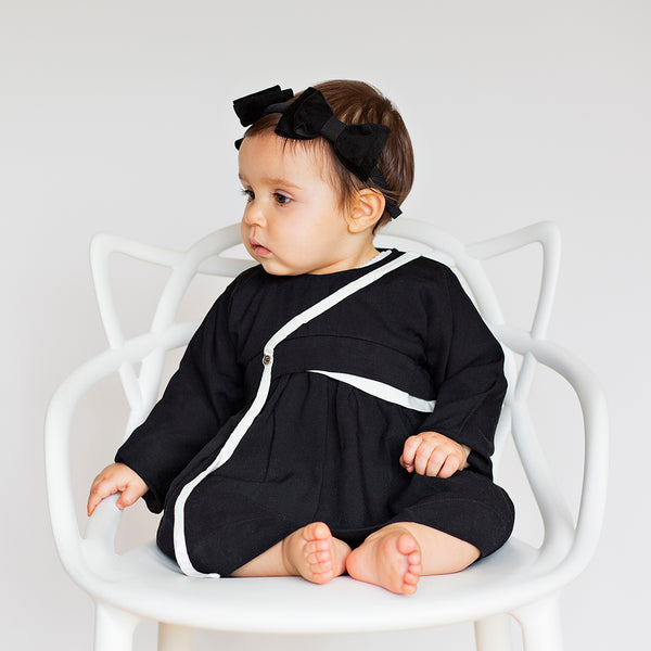 Baby girl wearing black dress with contrast details by Treehouse