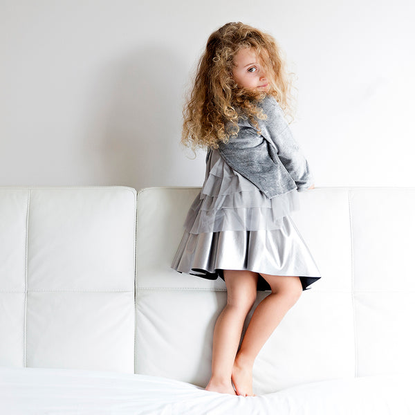 Girl wearing silver velvet sweater with back in tulle by Chichirikids