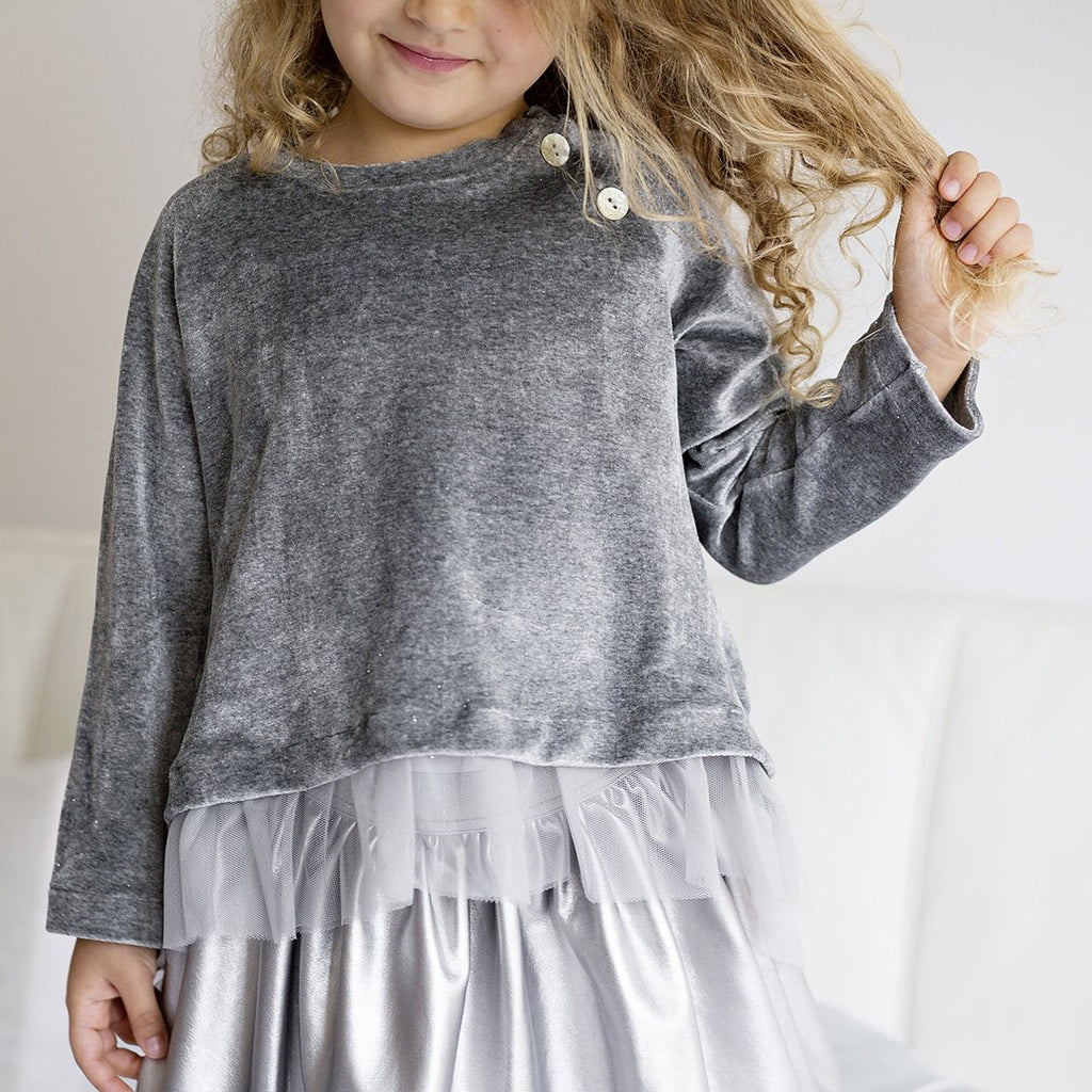 Girl wearing sweater with embellishments such as the back in tulle by Chichirikids