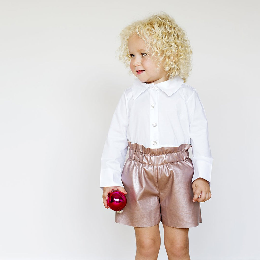 Girl wearing leatherette shorts by Chichirikids
