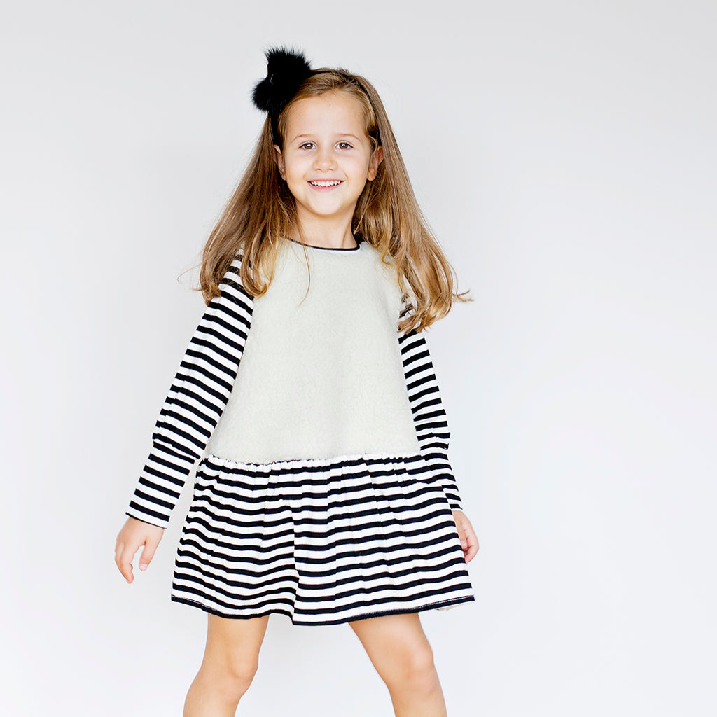 Girl in faux fur dress with eco wool and black and white striped by EFFVAÌ_