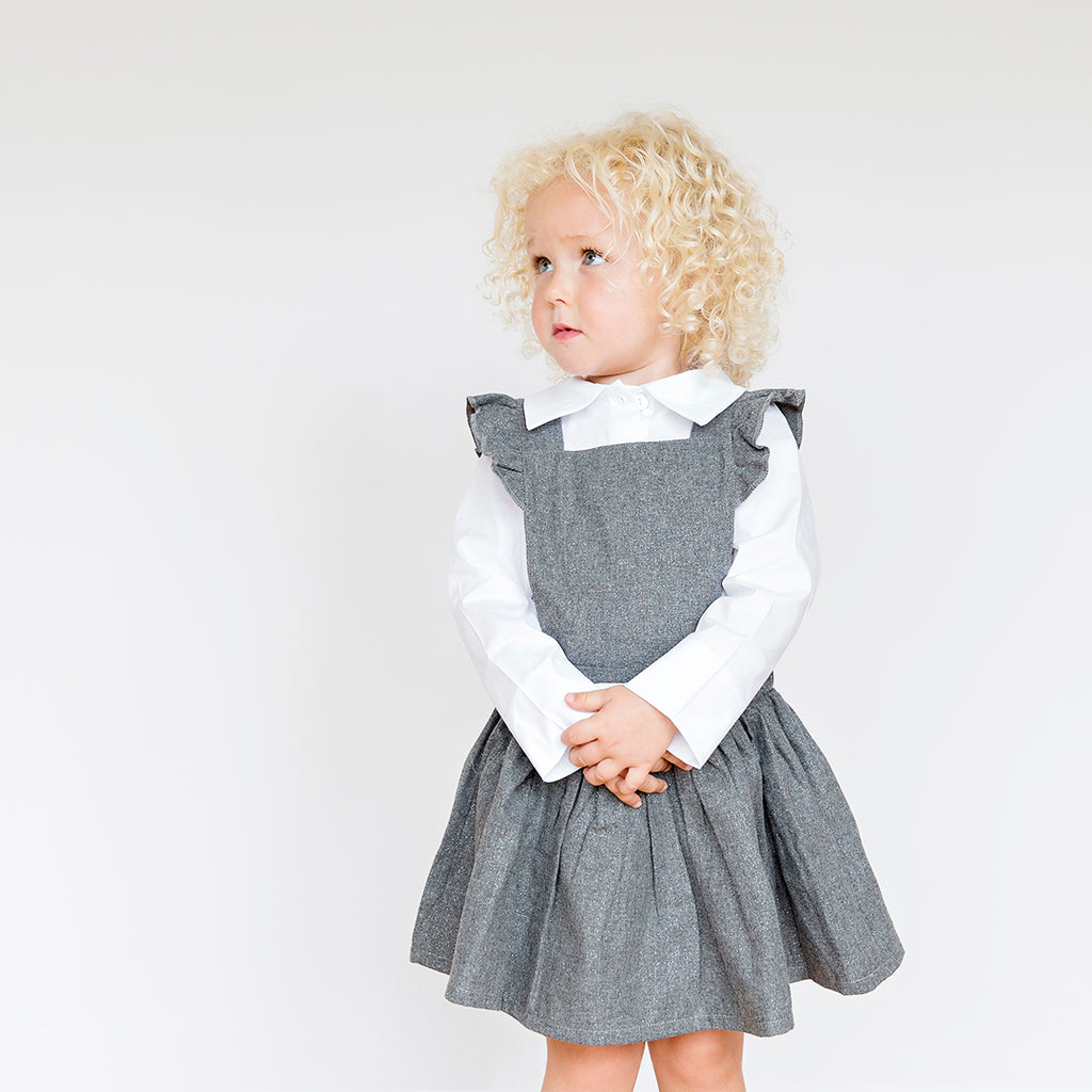 Girl wearing suspender dress in gray lurex by Chichirikids