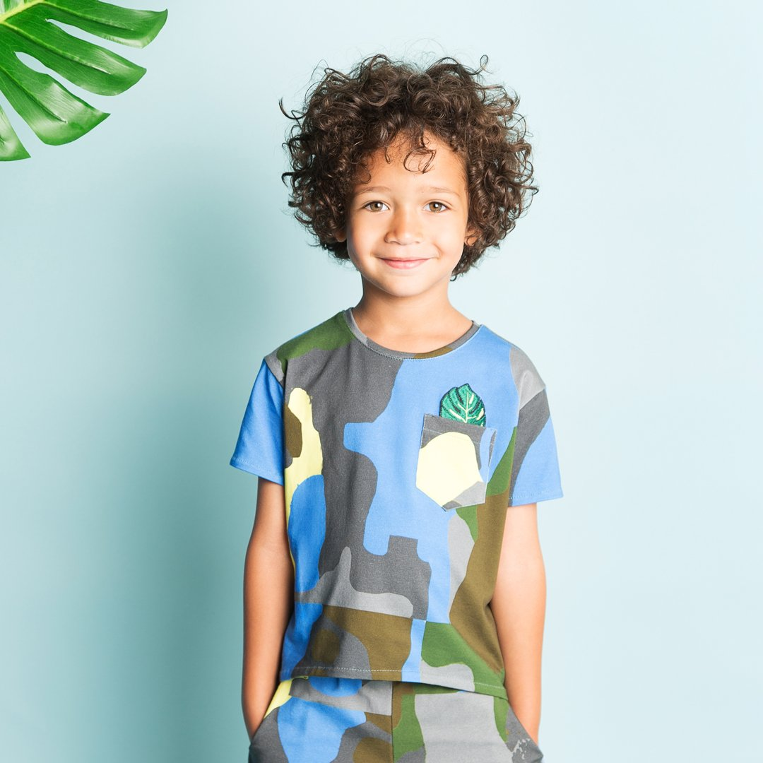 boy wearing a camouflage t-shirt by EFVVA