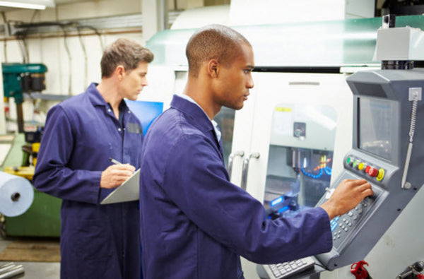 Engineers Using Automated Milling Machine