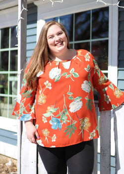 RUST FLORAL V NECK TOP