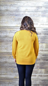 MUSTARD TOP WITH CHEETAH PRINT ARMS