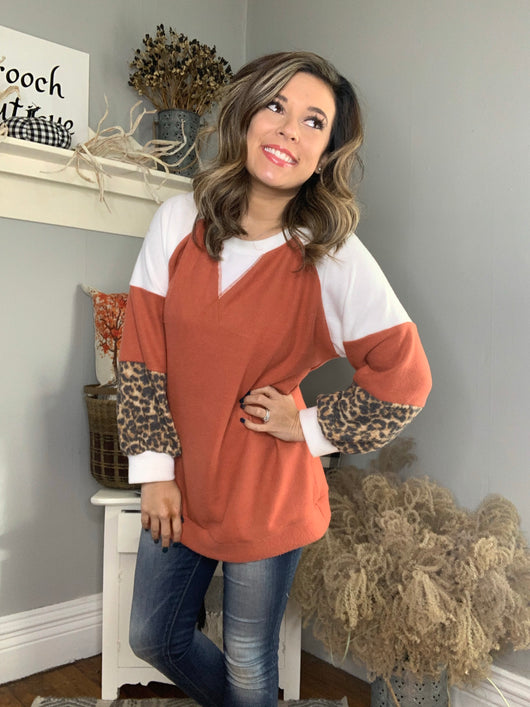 RUST BRUSHED KNIT TOP W/ ANIMAL CUFF