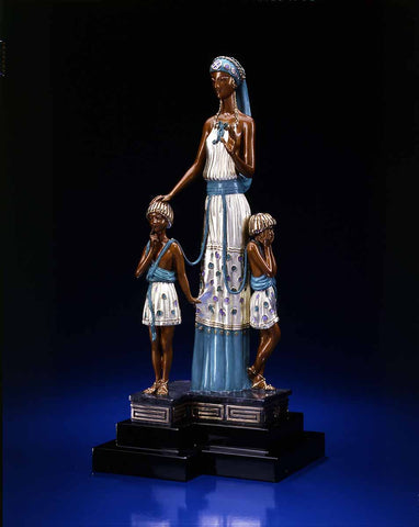 A sculpture of a Mother with two children