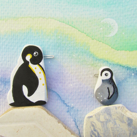 Pair of Pebble Penguins, Watercolour Northern Lights - Framed Beach Collage (No. 684)