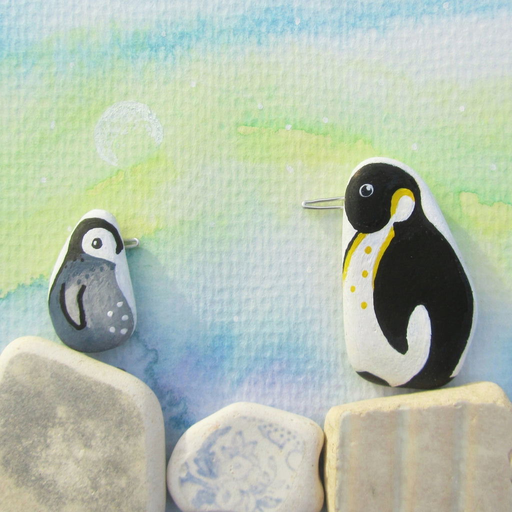 Pair of Pebble Penguins, Watercolour Northern Lights - Framed Beach Collage (No. 685)