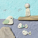 Pebble Seagull, Beach Pottery Lighthouse & Green Fish - Framed Beach Collage (No. 711)