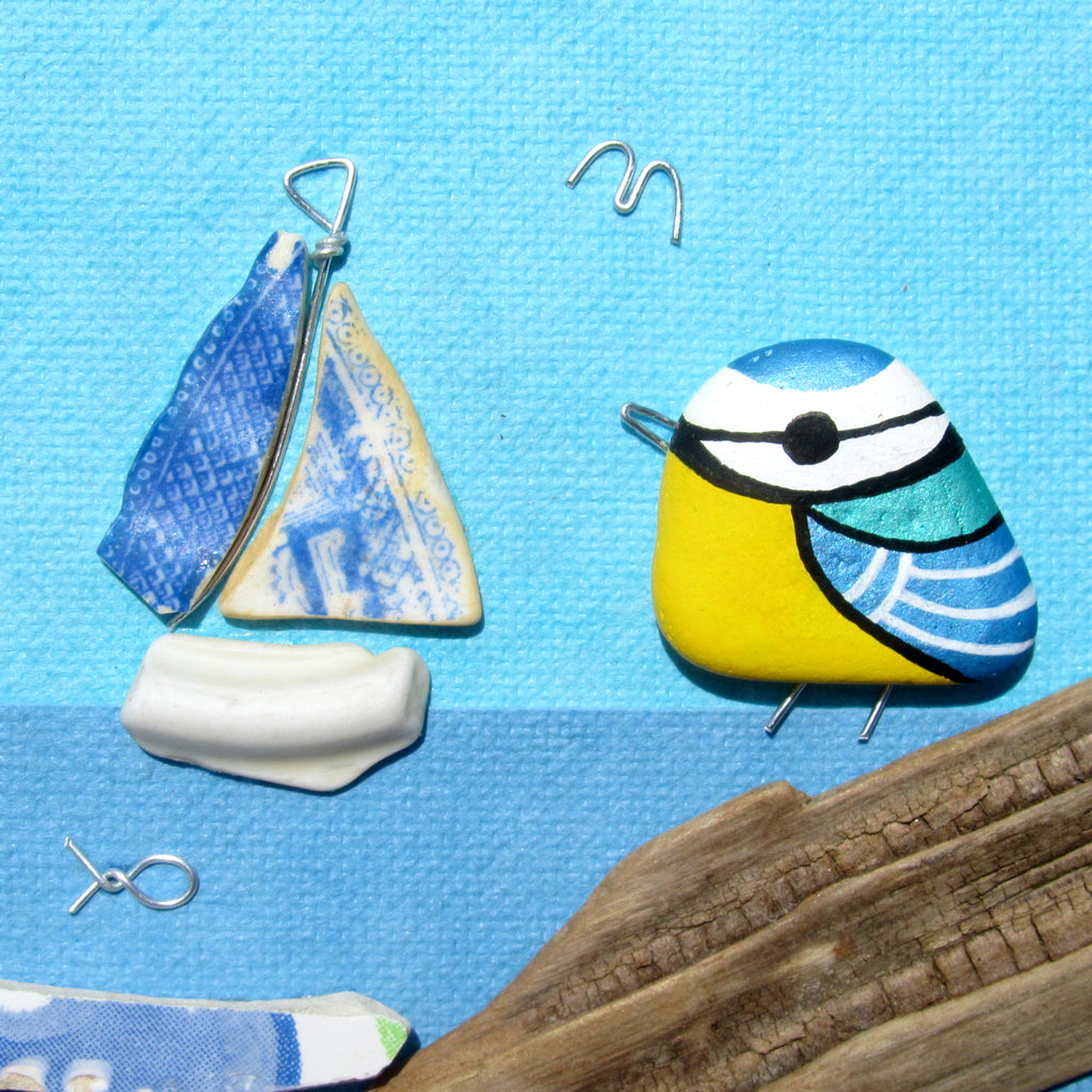 Blue Tit & Antique Pottery Sailing Boat - Beach Pebble Art Framed Picture (No. 782)
