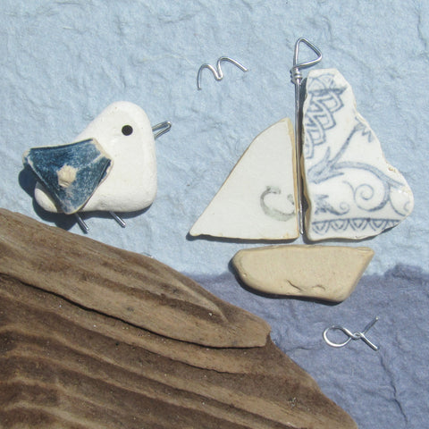 Pebble Seagull and Antique Pottery Sailing Boat at Dusk - Framed Beach Collage (No. 831)
