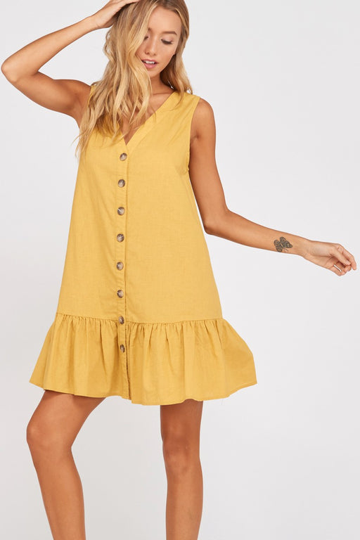 Easy as Pie shift dress mustard; Sleeveless buttoned ruffle hem shift dress in a easy breezy cotton/linen blend fabric. Features a decorative button closure, fully faced V neckline, wide ruffle hem and a relaxed fit. Pair with a pair of bright white tennis shoes for a casual look.; Wishlist; Gingerly Witty